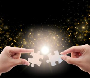 Two shiny puzzle pieces representing corporate innovation fit